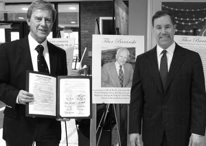 Erie County Legislator Ed Rath is shown with Tibor Baranski's son, Dr. Peter Forgach, left, who was presented with a memorial proclamation, honoring his father, during a community event on April 11.